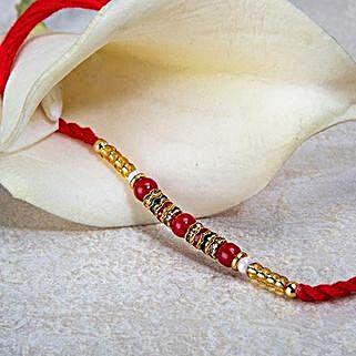 Red And Golden Bead Rakhi: Send Rakhi to Brazil