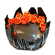 Chocolate Cake With Red Flowers: Bhai Dooj Gifts to Bhubaneshwar