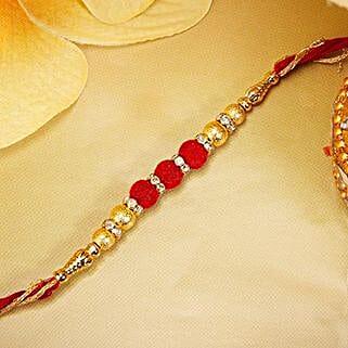 Gold And Red Velvet Beads Rakhi: Send Rakhi to Thailand