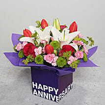 Tulips Roses and Carnations in Glass Vase: Flowers for Anniversary